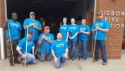"Approximately 100 volunteers participated in 10 project during the ""Doosan Days of Community Service"" in Gwinner. Volunteers helped paint the floor at the Lisbon Fire Department."