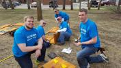 "During the first ""Doosan Days of Community Service,"" employee volunteers renovated a playground at the North Dakota Autism Center in Fargo."