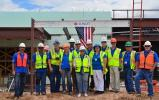 Project team members celebrate topping-out of the New Mexico State Veterans' Home Alzheimer's and Skilled Nursing Facility.