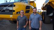 Dan Galusha (L) and Jamie Campagnone of Galusha & Sons, Queensberry, N.Y., look over this Volvo A40F articulated hauler.