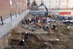 A construction crew discovered the graves as they were working on an apartment building (photo via AP News.)