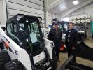 Lee Vanderlinde (L), grounds maintenance of Waconia, Minn., School District 110, and Dave Grandy, director of building and grounds of Waconia, Minn., School District 110, consider expanding the district's equipment fleet with this Bobcat S595 loader.