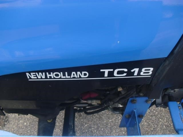 Detail photo of 2002 New Holland TC18 from Construction Equipment Guide